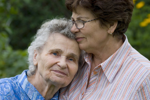 picture of elderly mother and adult daughter embracing