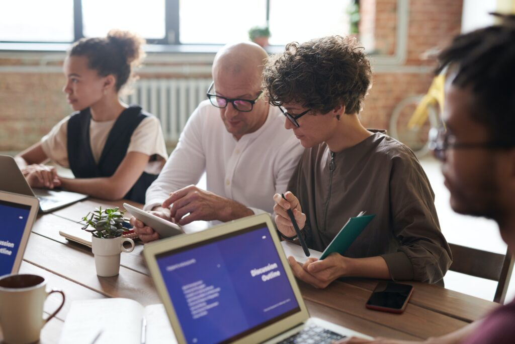 image of man and woman working at a desk